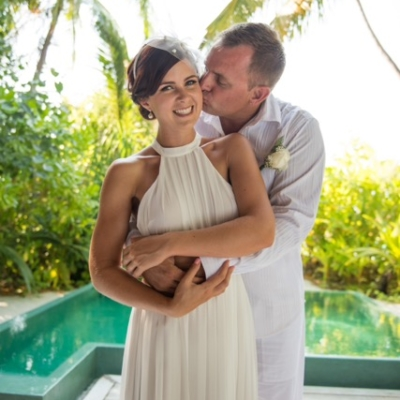 sweet couple kissing in a pool