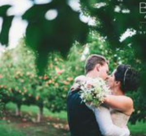 couple kissing a berry farm