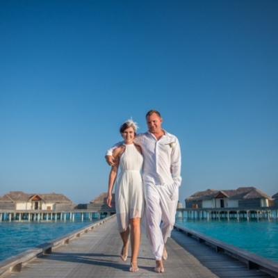 couple walking at a beach resort