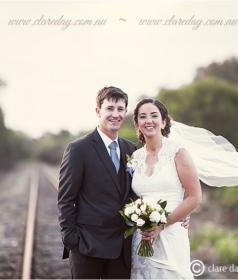 couple at a trail rail